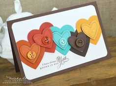 handmade Valentine ... die cut hearts in non-traditional colors ... like the way they fit together with the layered heart die cutting and popping ... buttons to match the rich colors ... awesome!! ...  Paper Trey Ink ...