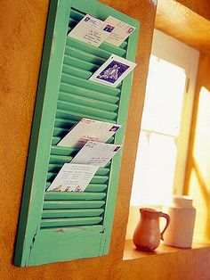 Love this ideas! USE FLEA-MARKET WINDOW SHUTTERS...smal for mail, larger for magazines!