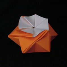 This StarPuff Box was created by Ilan Garibi.  It is an example of a crease-and-collapse design.  If you have never made an origami via crease and collapse, then this is a good day for you to try!