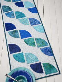 Drunkard's Path Table Runner By Atkinson, Terry  - 15in x 40in. Uses Creative Grids CGRATK1 and CGR812. Project Time: 2-6 Hour.