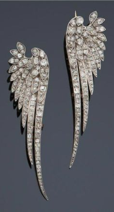 A pair of Belle Epoque diamond brooches, late 19th century. Designed as stylised wings, set with old- and rose-cut diamonds mounted in silver and gold. #DiamondBrooch