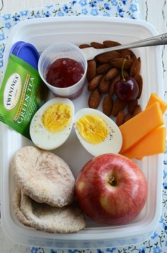 1 Hard-Boiled Egg; 3 Small Slices Cheese (about 3/4 oz); 1 Handful Unsalted Almonds (about 1 1/2 oz):  I also like walnuts, cashews, and sunflower seeds; 1 Apple:  Any piece of whole fruit will do; 2 Mini Whole Wheat Pitas:  Any healthy carb is perfect; 1 Tablespoon All-Fruit Jam:  This is optional – just for spreading on your bread; Green Tea; 1 Cherry