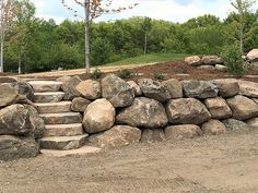 Rustic Waters provides the best landscape experience through superior customer service while always applying industry best practices for installations. Sloped Backyard Landscaping, Landscaping With Boulders, Stone Landscaping, Landscaping Retaining Walls, Sloped Garden, Rustic Landscaping, Landscaping Ideas, Rock Wall Landscape, Landscape Design