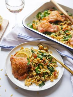 Mediterranean Chicken & Orzo Bake | For this one-pan recipe we're combining roasted chicken thighs with orzo pasta, lemon, garlic, sun-dried tomato, spinach and basil. Everything is cooked in the roasting tray so no washing up! Plus this recipe is ready in less than an hour - it couldn't be easier! | easy dinner recipes | roast chicken | orzo pasta recipe | 1 hour recipe | elizabethchloe.com | #chickenrecipe #orzorecipe #easyrecipe Gourmet Chicken, Mexican Chicken Recipes, Easy Chicken Dinner Recipes, Best Chicken Recipes, Easy Meals, Chicken Orzo, Roasted Chicken, Mediterranean Chicken, Mediterranean Recipes