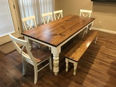 """Custom, handcrafted solid wood dining furniture by James+James. Rustic dining table with dining bench and farmhouse chairs.  This Baluster table is 7' L x 37"""" W with a jointed top stained Early American with a satin finish and Ivory painted base and legs. It is paired with a matching Dianne Bench and X-Back Dining Chairs."""