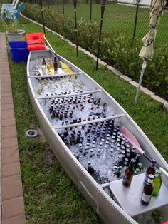 Beverage Station... I like the idea of using the seats as a place to cut the limes. I need to put the canoe on sturdy brackets (like they use at LLBean) to raise it to a convenient height.