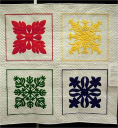 My Hawaiian Quilt by Jane Bachus.  Four traditional designs in four traditional colors make up this quilt.  Photo by Quilt Inspiration.