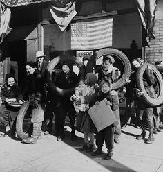 Children bringing scrap to the block Office of Civilian Defense headquarters. Chicago Nov. 1943.