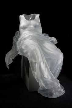 Reclining dress made from glass by  Karen LaMonte