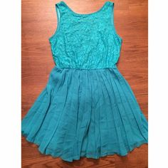"""Teal dress with v-neck back Dress has v-neck style in back. Has pleated skirt and lace overlay on top. Lace has some snagging to top. 33"""" long, 33"""" bust, 35"""" hips. I love H81 Dresses"""