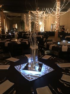 Good example of non floral centerpieces in black, white, and silver.