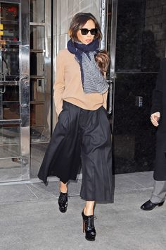 After a much lauded show early Sunday, designer Victoria Beckham was spotted on the streets of New York today in a decidedly fashionable, if technically ad