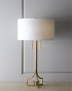 "Metal base with a burnished golden finish. Linen shade. Includes 4.5"" harp and rectangular finial. Two pull-chain sockets; uses two 100-watt bulbs. Approximately 18""Dia. x 32.75""T overall. Imported."