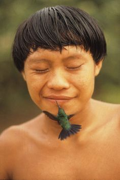 Famous photo showing a Yanomami Indian being kissed by a hummingbird // photo by Rosa Gauditano -- click to read article