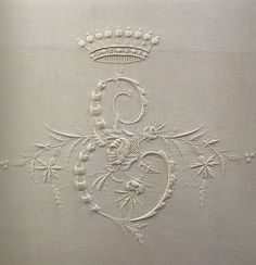 embroidered E initial