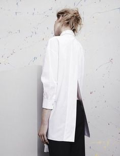 Contemporary Fashion - long white shirt with sleek split back detail; minimalist style