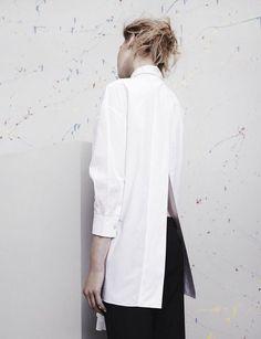 Contemporary Fashion - long white shirt with sleek split back detail; minimalist style