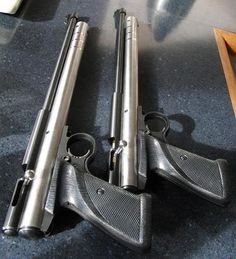 """Crosman 2240 Air Pistol.  This is a pair of 2240 PCP twins built by Clark. All of the stainless  go-faster bits are his own.    Barrel length: 12.9"""", Reservoir: 59cc, Fill Pressure: 220 bar, Maximum power: 40.4 ft-lbs (28.55gr Eun Jins @ 798fps) / 39.0 ft-lbs (16gr @ 1048 fps)  Shot count: 14 shots above 20 ft-lbs starting at a 220bar fill."""