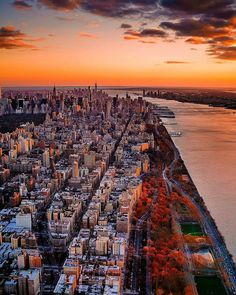 Beautiful Sunset over Manhattan by Chris Nova by newyorkcityfeelings.com - The Best Photos and Videos of New York City including the Statue of Liberty Brooklyn Bridge Central Park Empire State Building Chrysler Building and other popular New York places and attractions.