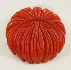 Art Deco deeply carved orange/red bakelite flower brooch