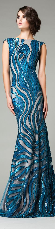 Look at this blue sequin evening gown that is sleeveless. The design and cut of this dress is beautiful. This haute couture evening dress could be easily replicated if you are on budget.  You can get pricing on custom evening dresses as well as replicas of couture pieces at www.dariusfashions.com
