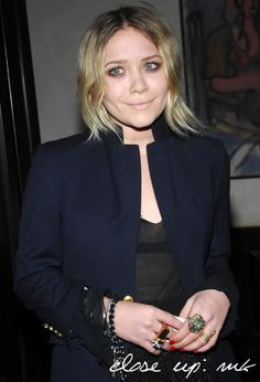 Close up of Mary-Kate Olsen with shimmery eyeshadow and nude lips. #style #fashion #olsentwins