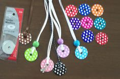 I tried my hand at making washer necklaces. I used polka dot vinyl on a wa.