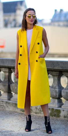 Yellow sleeveless coat for a strong silhouette and pop of color. See more coats on ShopStyle.com