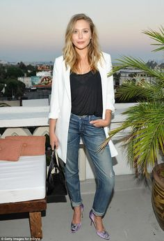 Cali girl: Elizabeth looked a bit more Malibu beach gal with her rolled up and worn jeans. She added a black top and a long white jacket with purple…