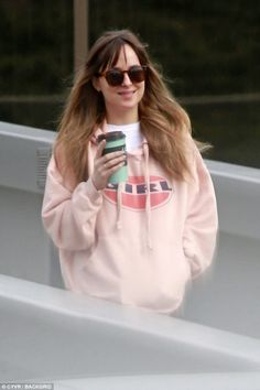 Be pretty in pink like Dakota wearing a Re/Done hoodie #DailyMail