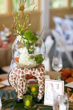 Giraffe table- Wedding at The Maryland Zoo in Baltimore. #tabledecor #wedding http://www.marylandzoo.org/visitor-information/rent-the-zoo/weddings/