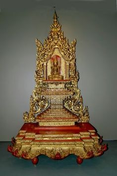 Throne for a Buddha image; 1850-1900; Burma; lacquered and gilt wood and metal with mirror inlay; Asian Art Museum, San Francisco, California. Such an elaborate throne and Buddha image would have been an important fixture of a nineteenth-century Burmese Buddhist temple, and similar ones can still be seen in temples today.