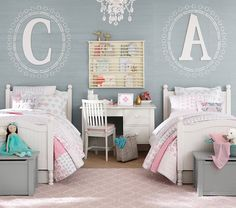 If we have two girls in a row...initial above headboard, toy box at the end of…