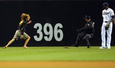 Game #56 6/5/12: A fan runs into the field during the San Francisco Giants against the San Diego Padres MLB Game on June 5, 2012 at Petco Park in San Diego, California. (Photo by Donald Miralle/Getty Images)