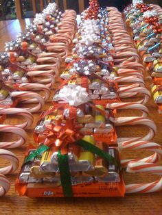 Candy sleighs...candy cane runners, hot glued to a kit Kathy bar, topped with 10,ini Hershey bars in different favors.  Tied off with ribbon and a small bow on top...great Hostess gift, or Christmas party favor