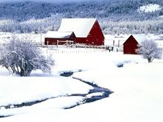 Red barns in the snow, along a winding creek...