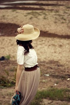 White blouse. Nude skirt. Brown belt. Tan sunhat. Blue sandals.