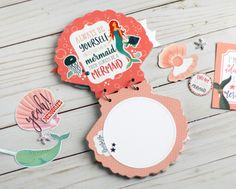 """Seashell shaped mini album by Anya Lunchenko featuring the """"Mermaid Tales"""" collection by #EchoParkPaper"""