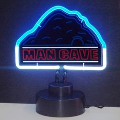 The Mancave Neon Sculpture by Neonetics features multi-colored, hand blown neon tubing. The Mancave Neon Sculpture plugs into a black base, which fully houses all the electronics. The base has an on a
