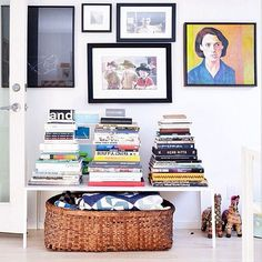 23 Bookcases To Lust Over — & Copy Immediately  #refinery29  http://www.refinery29.com/best-bookcase-decorating-ideas#slide-8  Who needs a bookcase when you can craft a pyramid atop a table?