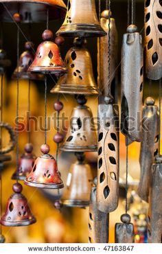 stock photo : Traditional bells made of clay and wood hung on strings