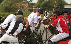 Caught in the middle of the match, Prince William (centre, wearing glasses) competes in th...