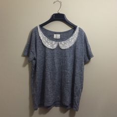 UO Tee with Crochet Detail Soft gray tee by Pins and Needles from Urban Outfitters with cream crochet detailing around the neck. Size M, true to size. Worn only once. Contact seller for more information. No trades. Urban Outfitters Tops Tees - Short Sleeve