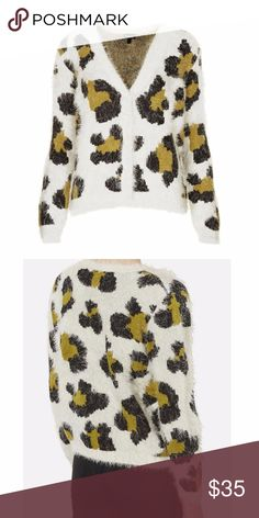 """Topshop Leopard Spot Jaquard Fuzzy Cardi US8 Topshop Leopard Spot Jacquard Fuzzy Cardigan Size US 8 / UK 12 / EUR 40 Feathery strands soften this ultra-fuzzy jacquard cardigan purring with loads of big-cat attitude. Super soft and cozy! Mostly white with oversized leopard spots in gold/mustard and black.  Great edgy statement piece.  Oversized fit.  21"""" underarm to underarm.  22.5"""" shoulder to hem.  All lying flat.  $75 retail. Excellent condition with no flaws noted.    B3C4O17 Topshop…"""