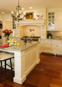I really need a kitchen like this. At least....with that same bright and spacious feel! LOVE this.
