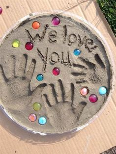 Stepping stone with handprints: