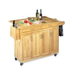 "Home Styles Wood Top Kitchen Cart - BedBathandBeyond.com $399.99 Measures 54"" W x 18-1/2"" D x 36-1/4"" H Extends to 30"" D when extended"