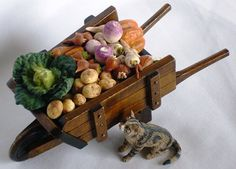 A Lovely Wooden Wheelbarrow With Freshly Harvested Vegetables