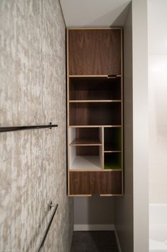 Floating cabinet in niche - reveals, combination of finished, finger cut outs for doors by Kerf Design