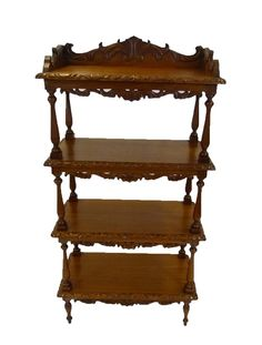 Attractive light mahogany whatnot. A substantial display sheving unit with intricate carvings, turned pillars and legs.  Timeless Classic at www.resourcevintage.co.uk